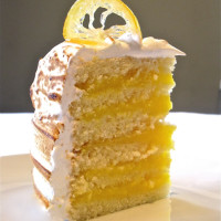 A slice of Lemon Layer Meringue Cake